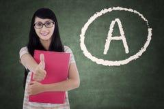 Teenage girl showing thumb up Stock Image