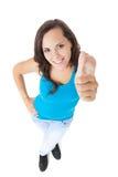 Teenage girl showing thumbs up Royalty Free Stock Photo