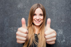Teenage girl showing thumbs up Stock Images