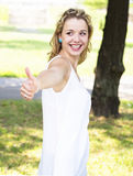 Teenage girl showing thumbs up Royalty Free Stock Images