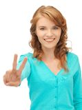 Teenage girl showing victory sign Royalty Free Stock Image