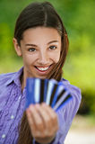 Teenage girl shows credit card Stock Photography