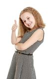 Teenage girl shows the hand gesture thumb up Royalty Free Stock Photos