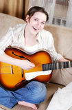Teenage girl singing by guitar Stock Photos
