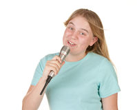 Teenage girl singing karaoke Royalty Free Stock Photo