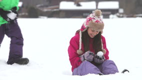 Teenage girl sits in snow  stock video