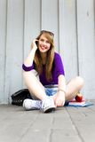 Teenage girl sitting Royalty Free Stock Image