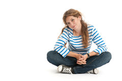 Teenage girl sitting Stock Photos
