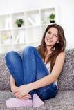 Teenage girl sitting Stock Photography