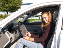 Teenage girl sitting in car Stock Photo