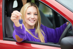 Teenage Girl Sitting In Car Holding Key Stock Photos