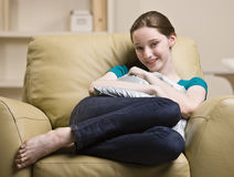 Teenage girl sitting in chair Stock Images