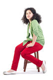 Teenage girl sitting on a chair Royalty Free Stock Images