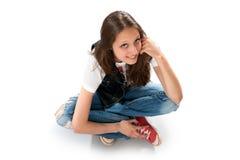 Teenage girl sitting on the floor Stock Image