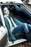 Teenage girl sitting in a car stock photos