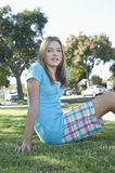 Teenage Girl Sitting On Grass Royalty Free Stock Photography