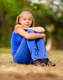 Teenage girl sitting on green Royalty Free Stock Photo