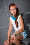 Teenage Girl Sitting In Studio Royalty Free Stock Images