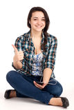 Teenage girl sitting and listen music Royalty Free Stock Images