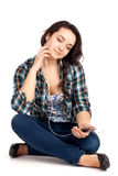 Teenage girl sitting and listen music Royalty Free Stock Photos
