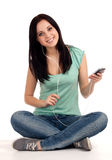 Teenage girl sitting and listening nusic Royalty Free Stock Photos