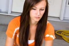Teenage Girl Sitting Outside Stock Photography