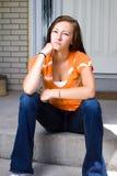 Teenage Girl Sitting Outside Stock Photo