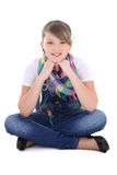 Teenage girl sitting over white. Background royalty free stock photography