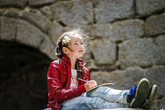 Teenage girl sitting and painting Royalty Free Stock Photos