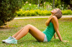 Teenage girl sitting in the park Stock Images