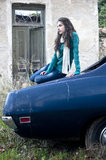 Teenage girl sitting on a car stock images