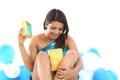 Teenage girl sitting with present box Stock Photo