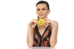 Teenage girl sitting with smile ball Royalty Free Stock Photos