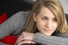 Teenage Girl Sitting On Sofa Royalty Free Stock Image