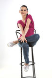 Teenage girl sitting on studio chair Royalty Free Stock Images