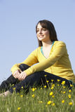 Teenage Girl Sitting In Summer Meadow Royalty Free Stock Photos