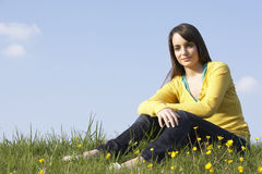 Teenage Girl Sitting In Summer Meadow Stock Image