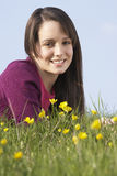 Teenage Girl Sitting In Summer Meadow Royalty Free Stock Photo