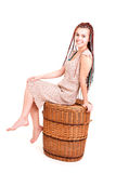 Teenage girl sitting on the wicker box Royalty Free Stock Image