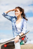 Teenage girl with skate outside Stock Photo