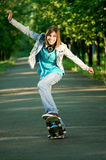 Teenage girl with skateboard Royalty Free Stock Image