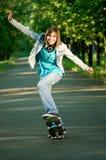 Teenage girl with skateboard royalty free stock image