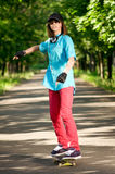 Teenage girl with skateboard Royalty Free Stock Photography