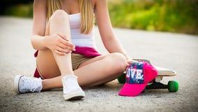 Teenage girl with skateboard Stock Photos