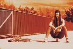 Teenage girl skater riding skateboard on street. Royalty Free Stock Photo