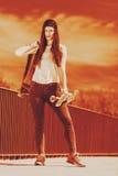 Teenage girl skater riding skateboard on street. Royalty Free Stock Photos