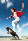 Teenage girl skating outside Royalty Free Stock Photo