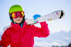 Teenage girl skiing in Swiss Alps. Teenage girl skiing in Swiss Alps in Sunny Day Stock Image