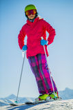 Teenage girl skiing in Swiss Alps. Teenage girl skiing in Swiss Alps in Sunny Day Stock Images