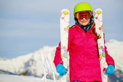 Teenage girl skiing in Swiss Alps. Teenage girl skiing in Swiss Alps in Sunny Day Stock Photo